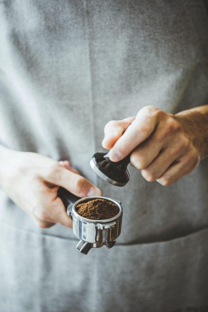 Barista ready for making classic espresso